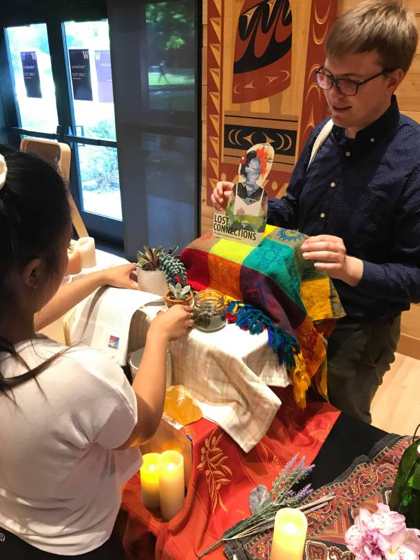 Photo by Estey Chen; Trish Hoy and Anders Peterson setting up our ofrenda; Feminista Futurisms: Afro-Indigenous Muxeres in Hip Hop; Intellectual House, Seattle, USA; 6/3/2019; Group 1 Setting Up